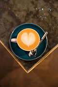 A flat white coffee on a marble table on the 7th July 2018 in central London in the United Kingdom.