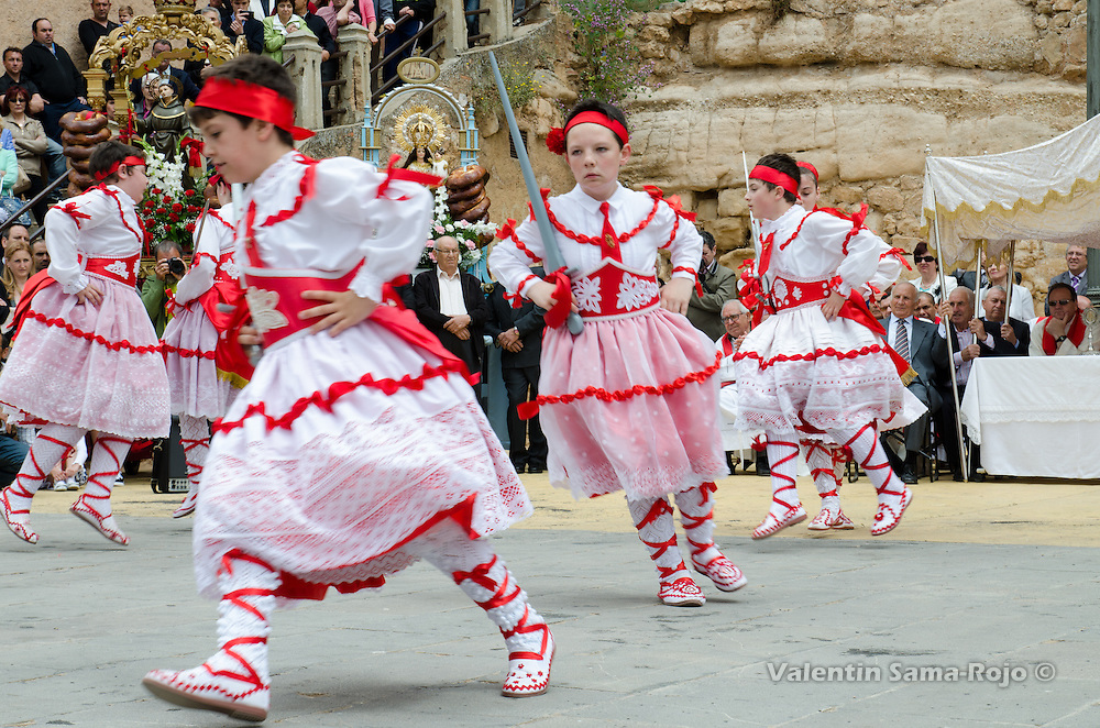 Dancers dancing the 'Contradanza' during the performance of the 'Dance' at the main square of Cetina using wooden swords.