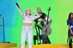 Anne-Marie and Grace Chatto from Clean Bandit during Capital's Summertime Ball with Vodafone at Wembley Stadium, London. This summer's hottest artists performed live for 80,000 Capital listeners at Wembley Stadium at the UK's biggest summer party. Performers included Camila Cabello, Shawn Mendes, Rita Ora, Charlie Puth, Jess Glyne, Craig David, Anne-Marie, Rudimental, Sean Paul, Clean Bandit, James Arthur, Sigala, Years & Years, Jax Jones, Raye, Jonas Blue, Mabel, Stefflon Don, Yungen and G-Eazy