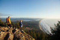 Two people hiking on Neahkahnie Mountain near Manzanita, Oregon.