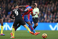 Wilfried Zaha of Crystal Palace is intercepted by Nolito of Manchester City. Premier League match, Crystal Palace v Manchester city at Selhurst Park in London on Saturday 19th November 2016. pic by John Patrick Fletcher, Andrew Orchard sports photography.