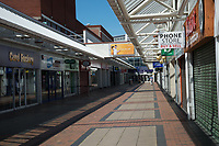 Despite being a UK Bank Holiday, normally busy Liverpool high streets and public transport are empty, a few queues outside main shops for essential shopping, most shops display safety Signs and covid 19 signage, about social distancing and support for NHS staff. Birkenhead Liverpool. 25.05.20