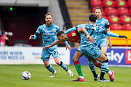 Max Melbourne of Walsall   battles for possession with Forest Green Rovers Odin Bailey(17)On loan from Birmingham City during the EFL Sky Bet League 2 match between Walsall and Forest Green Rovers at the Banks's Stadium, Walsall, England on 10 April 2021.