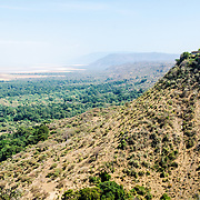 A view out over Lake Manyara National Park from an elevated point just outside the park. At right, on the top of the headland, is one of the luxury resorts.