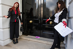London, UK. 2 July, 2019. Climate change activists from Extinction Rebellion Art and Culture try to deliver a letter to energy company Repsol S.A. during a silent procession to visit the offices of five major oil companies - ENI, CNPC, Saudi Aramco, Repsol and BP - in order to declare them as crime scenes.