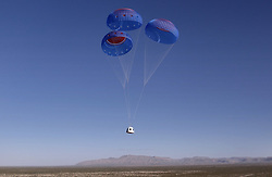 Handout photo dated October 13, 2021 of the New Shepard NS-18 crew capsule descends toward a safe landing at Launch Site One. Hollywood actor William Shatner has become the oldest person to go to space as he blasted off aboard the Blue Origin sub-orbital capsule. The 90-year-old, who played Captain James T Kirk in the Star Trek films and TV series, took off from the Texas desert with three other individuals. Mr Shatner's trip on the rocket system - developed by Amazon.com founder Jeff Bezos - lasted about 10 minutes. Photo by Blue Origin via ABACAPRESS.COM