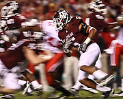 Nov 20, 2010; College Station, TX, USA; Texas A&M Aggies cornerback Coryell Judie (5) returns a kick against the Nebraska Cornhuskers during the first quarter at Kyle Field.  Mandatory Credit: Thomas Campbell-US PRESSWIRE