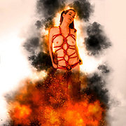 Digitally enhanced image of topless model tied with red rope burning at a stake
