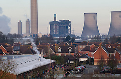 © Licensed to London News Pictures. 24/02/2016. Didcot, UK. A view over the town of Didcot in Oxfordshire shows a scene of wreckage where three workers are missing and one died when an explosion caused part of Didcot power station to collapse. The site was undergoing preparation for demolition in the coming weeks.   Photo credit: Peter Macdiarmid/LNP
