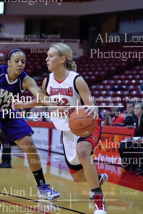 03 November 2009: Maggie Krick drives to the basket guarded by Danielle Roe  during a game between Panthers of Kentucky Wesleyan and the Redbirds of Illinois State University on Doug Collins Court inside Redbird Arena in Normal Illinois.