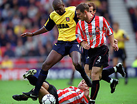 Patrick Vieira (Arsenal) challenged by Chris Makin (Sunderland). Sunderland 1:0 Arsenal. FA Premiership,19/8/2000. Credit Colorsport / Stuart MacFarlane.