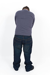 Portrait of the back of a teenage boy with Downs Syndrome,