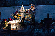 An elderly man lights candles at the decorated gravesite of his son for the Day of the Dead festival October 31, 2017 in Tzintzuntzan, Michoacan, Mexico.