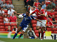Photo: Rich Eaton.<br /> <br /> Barnsley v Cardiff City. Coca Cola Championship.<br /> <br /> 05/08/2006. Michael Chopra for Cardiff and Barnsleys Antony Kay go for the ball