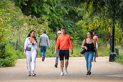 © Licensed to London News Pictures. 07/09/2020. London, UK. After the wind and rain, walkers in Hyde Park enjoy some warm weather as a mini heatwave is expected to hit the South East this week with temperatures predicted to reach up to 24c. Photo credit: Alex Lentati/LNP