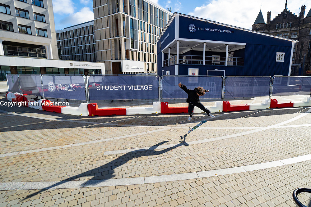 Edinburgh, Scotland, UK. A skateboarder makes the most of a very quiet Bristo Square at the University of Edinburgh. A temporary student bar has been constructed to allow greater social distancing between students on campus. Iain Masterton/Alamy Live News