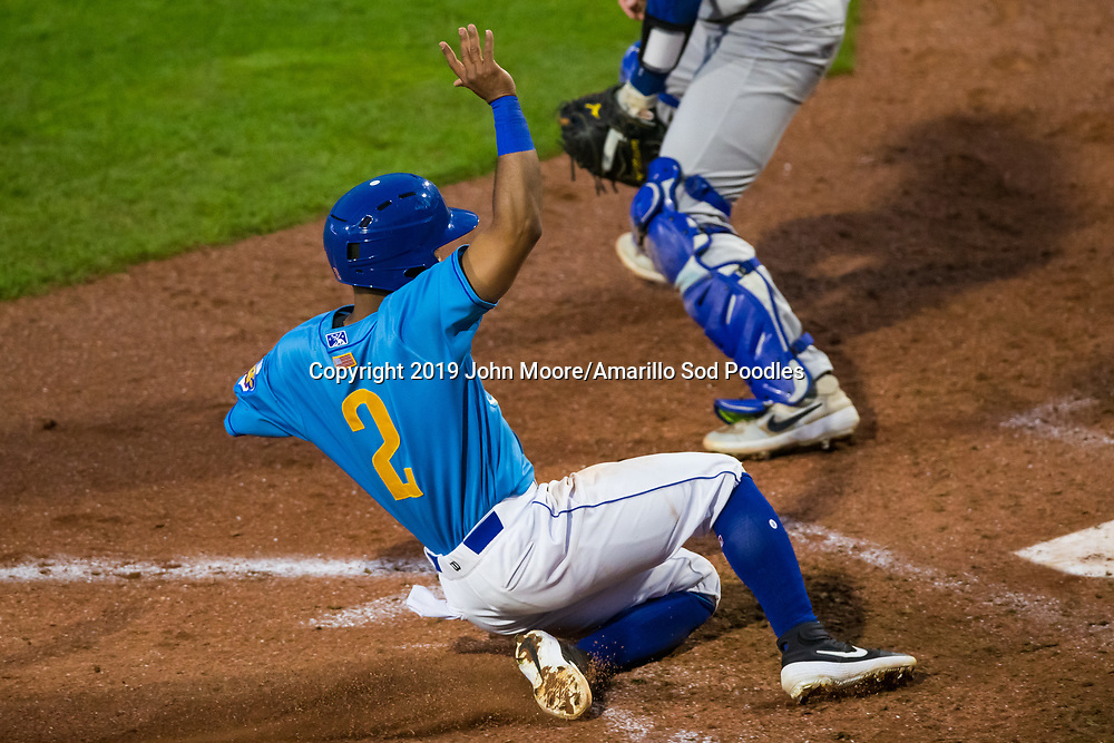 Amarillo Sod Poodles infielder Ivan Castillo (2) slides into home against the Midland RockHounds on Saturday, May 25, 2019, at HODGETOWN in Amarillo, Texas. [Photo by John Moore/Amarillo Sod Poodles]
