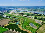 Nederland, Gelderland, Gemeente Druten, 14–05-2020; overzicht Afferdense en Deestse Waarden, met nevengeul, recreatiegebied en voormalige steenfabriek Turkswaard. In de voorgrond de Waalbandijk (met dijkmagazijn) direct ten westen van Deest, rivier de Waal in de achtergrond.<br /> Overview Afferdense and Deestse Waarden, with secondary channel, recreation area and former brick factory Turkswaard. In the foreground the Waalbandijk (with dike warehouse) immediately west of Deest, river Waal in the background.<br /> <br /> luchtfoto (toeslag op standaard tarieven);<br /> aerial photo (additional fee required)<br /> copyright © 2020 foto/photo Siebe Swart