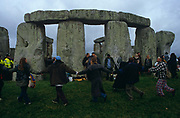 Visitors to the ancient site of Stonehenge celebrate the Summer Solstice on the morning of June 21st - the longest day - by dancing in circles while holding hands. The Stonehenge site is a place of pilgrimage for neo-druids and those following pagan or neo-pagan beliefs. The midsummer sunrise began attracting modern visitors in 1870s. Today the stones are owned by English Heritage, the guardians of ancient and historical structures. Most years, substantial police and barriers prevent on-lookers from approaching the stones but on this occasion, revellers were allowed to party long after the early 4.15am sunrise. Stonehenge is a Neolithic and Bronze Age megalithic monument located near Amesbury in the English county of Wiltshire. Composed of earthworks surrounding a circular setting of large standing stones it is one of the most famous prehistoric sites in the world. Archaeologists think that the standing stones were erected between 2500 BC and 2000 BC and served as an outdoor observatory from where to watch the constellations. The site and its surroundings were added to the UNESCO's list of World Heritage Sites in 1986.