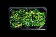 pickled seaweed, isolated on black background