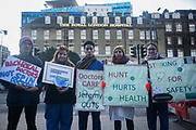 Junior doctors and supporters leaflet and collect signatures outside White Chapel tube station, near the Royal London Hospital.  Junior doctors all over the country are on a one day strike against the proposed new working conditions and pay by the Government.