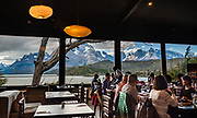 Admire Cerro Paine Grande and Los Cuernos (the Horns) from Hosteria Lago Grey's dining room, in Torres del Paine National Park, Chile, Patagonia, South America. The Park is listed as a World Biosphere Reserve by UNESCO.