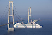 Independence of the Seas sails under the Storebelt Bridge in Denmark on it's inaugural voyage from the ship yard in Finland to Southampton UK.