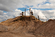 Mound of gravel that was used to place a separation ramp for gold sediments in Delta 1, one of the main gold mining towns in the Peruvian Amazon.