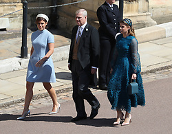 Princess Eugenie (left), the Duke of York and Princess Beatrice arrive at St George's Chapel in Windsor Castle for the wedding of Prince Harry and Meghan Markle.