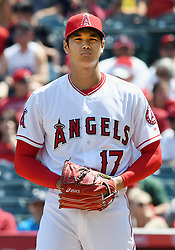 April 8, 2018 - Anaheim, CA, U.S. - ANAHEIM, CA - APRIL 08: Los Angeles Angels of Anaheim pitcher Shohei Ohtani (17) in action during the first inning of a game against the Oakland Athletics played on April 8, 2018 at Angel Stadium of Anaheim in Anaheim, CA (Photo by John Cordes/Icon Sportswire) (Credit Image: © John Cordes/Icon SMI via ZUMA Press)