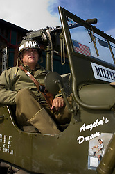"""A reenactor portrays a sergeant from the American 101st Airborne """"Screaming Eagles"""" armed with a Colt 45 Automatic Pistol carried in a shoulder holster and wearing an MP (Military Police) steel helmet  <br /> 4 September 2009  Copyright Paul David Drabble"""