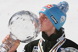 Best overall individual in World cup standings Gregor Schlierenzauer (Austria) kissing the cup at Flying Hill Individual in 4th day of 32nd World Cup Competition of FIS World Cup Ski Jumping Final in Planica, Slovenia, on March 22, 2009. (Photo by Vid Ponikvar / Sportida)