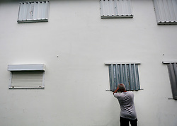 October 7, 2016 - Florida, U.S. - Winthrop Bourne takes down shutters from the window of his condo Friday moring after the passing of Hurricane Matthew, Octobor 7, 2016  in Lake Worth. (Credit Image: © Yuting Jiang/The Palm Beach Post via ZUMA Wire)