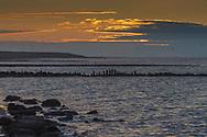 Foto van zonsondergang boven de Waddenzee bij Sexbierum