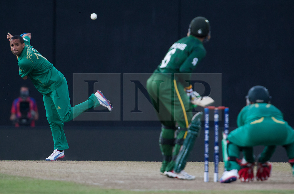 © Licensed to London News Pictures. 28/09/2012. South African bowler Robin Peterson bowling during the T20 Cricket World cup match between South Africa Vs Pakistan at the R.Premadasa Cricket Stadium,Colombo. Photo credit : Asanka Brendon Ratnayake/LNP