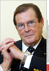 © Greg Soussan/ABACA. 42159-4. UNICEF Goodwill Ambassador Roger Moore pose for our photographer at the George V Four Seasons hotel. He is in Paris to tape the tv show Absolument 70 (Absolutely 70's) for the M6 tv channel.
