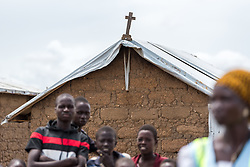30 May 2019, Mokolo, Cameroon: A cross decorates the roof on one of the houses in Minawao. The Minawao camp for Nigerian refugees, located in the Far North region of Cameroon, hosts some 58,000 refugees from North East Nigeria. The refugees are supported by the Lutheran World Federation, together with a range of partners.