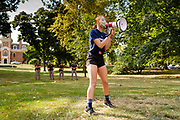 07 SEPTEMBER 2020 - DES MOINES, IOWA: TABITHA KEITH, a Roosevelt High School volleyball player, uses a bullhorn to talk to students gathered at the Iowa Governor's Mansion. About 300 Des Moines Public School (DMPS) high school athletes marched through Des Moines to the Governor's Mansion Monday to protest Gov. Kim Reynolds' recent efforts to reopen schools. DMPS, the largest school district in Iowa, is suing to go to online instruction because of the COVID-19 pandemic. The Governor is trying to force the district to reopen with in person instruction. The state ruled that schools using online education can't participate in extracurricular activities, including sports. The student athletes, who all wore face masks to comply with CDC guidelines, were marching to demand the ability to participate in sports despite using online instruction.      PHOTO BY JACK KURTZ