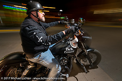 Riding Main Street at night on the last day of the annual Sturgis Black Hills Motorcycle Rally. Sturgis, SD. USA. Saturday August 12, 2017.  Photography ©2017 Michael Lichter.