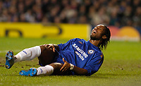 Photo: Leigh Quinnell.<br /> Chelsea v Liverpool. UEFA Champions League. <br /> 06/12/2005. Chelseas Didier Drogba in pain with an injury.