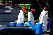 A haz-mat crew prepares to clean the apartment where a third Ebola patient lives in Dallas, Texas on October 15, 2014. (Cooper Neill for The New York Times)