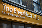 Sign for The Breakfast Club restaurant in Soho, London, England, United Kingdom. The Breakfast Club is incredibly popular amongst young people who are seen queueing outside at each of the sites of this trendy cafe, although they insist this should be known as a caf.