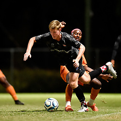 BRISBANE, AUSTRALIA - NOVEMBER 3: Ewan Macleod of the Knights evades a tackle from Abrahim Yango of Eastern Suburbs during the NPL Queensland Senior Mens Round 9 match between Eastern Suburbs FC and Gold Coast Knights at Heath Park on November 3, 2020 in Brisbane, Australia. (Photo by Patrick Kearney)