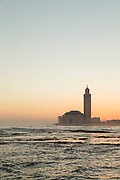 Sea and Hassan II Mosque at sunset in Casablanca, Morocco