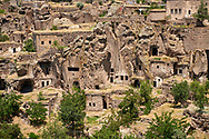 """Pictures & images of Guzelyurt cave city across the the Vadisi Monastery Valley, """"Manastır Vadisi"""",  Ihlara Valley, Guzelyurt , Aksaray Province, Turkey. .<br /> <br /> If you prefer to buy from our ALAMY PHOTO LIBRARY  Collection visit : https://www.alamy.com/portfolio/paul-williams-funkystock/vadisi-monastery-valley-turkey.html<br /> <br /> Visit our TURKEY PHOTO COLLECTIONS for more photos to download or buy as wall art prints https://funkystock.photoshelter.com/gallery-collection/3f-Pictures-of-Turkey-Turkey-Photos-Images-Fotos/C0000U.hJWkZxAbg"""