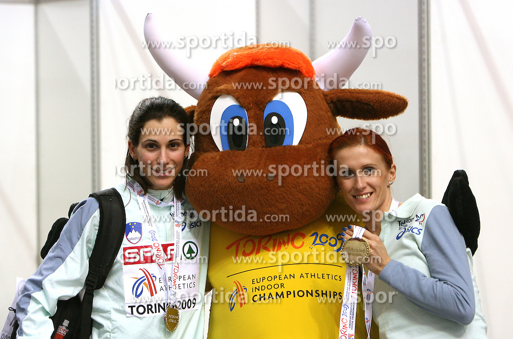 Marija Sestak of Slovenia placed second at the final of Women Triple  jump, Official Mascotte and Sonja Roman, third at the 1500m women run at the 3rd day of  European Athletics Indoor Championships Torino 2009 (6th - 8th March), at Oval Lingotto Stadium,  Torino, Italy, on March 8, 2009. (Photo by Vid Ponikvar / Sportida)