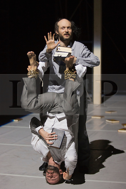 """© Licensed to London News Pictures. 24/01/2014. London, England. Pictured: Sidi Larbi Cherkaoui, top, and Dimitri Jourde, bottom. Belgian dancer/choreographer Sidi Larbi Cherkaoui's work """"Apocrifu"""" uses the language of the body to explore apocryphal religious texts, accompanied by the polyphonic singing from the all-male Corsican vocal ensemble """"A Filetta"""". Dancers: Sidi Larbi Cherkaoui, Dimitri Jourde and Yasuyuki Shuto. Performances at the Queen Elizabeth Hall, Southbank Centre from 24th to 25the January 2014. Photo credit: Bettina Strenske/LNP"""