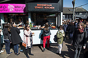 Food stalls selling street food at the busy hang out for young Londoners and tourists in Camden Town, London, England, United Kingdom. Camden Town is famed for its market, warren of fashion and shops near Regent's Canal, and is a haven of alternative counter culture.