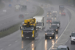 © Licensed to London News Pictures. 10/07/2014<br /> Drivers on the M25 this afternoon near the Swanley junction in Kent. 2.50pm.<br />  Kent under the weather today (10.07.2014) as heavy rain all day is starting to cause flash flooding and make the roads dangerous for drivers.<br /> (Byline:Grant Falvey/LNP)