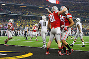 Nick Vannett #81 of the Ohio State Buckeyes celebrates with teammates after catching a 1-yard-touchdown pass against the Oregon Ducks during the College Football Playoff National Championship Game at AT&T Stadium on January 12, 2015 in Arlington, Texas.  (Cooper Neill for The New York Times)